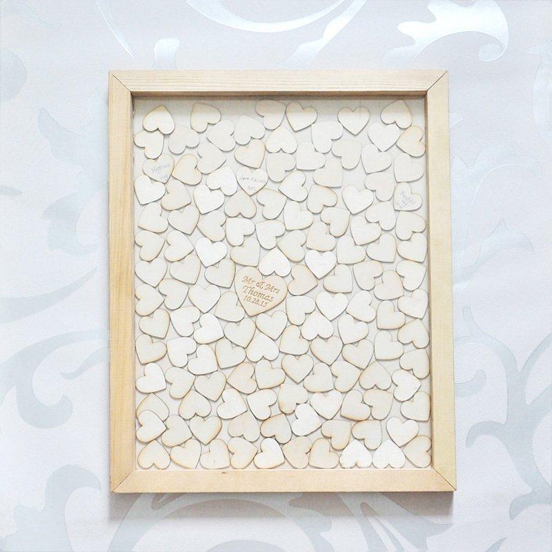 Guestbook matrimonio: pannello decorativo con cuoricini intagliati