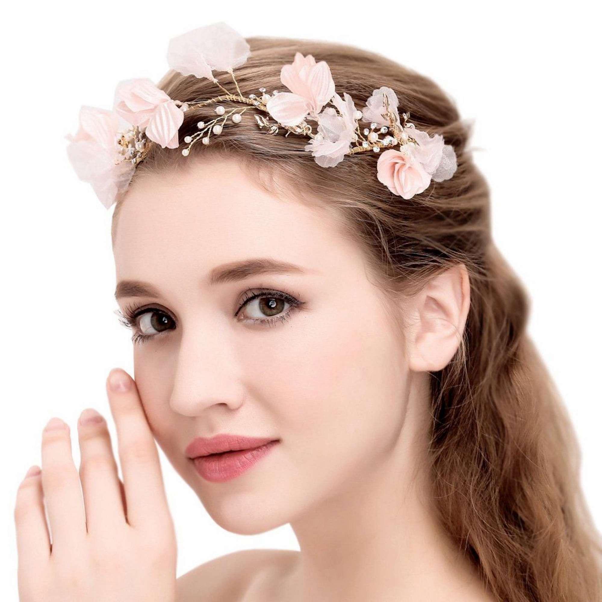 Accessorio per capelli con fiori rosa